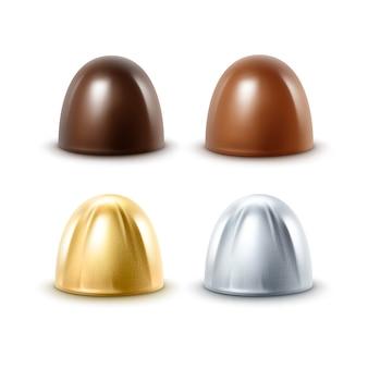 Set di cioccolato al latte nero in foglia argento dorato