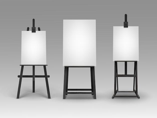 Set di cavalletti in legno nero con mock up tele verticali vuote vuote isolate su priorità bassa