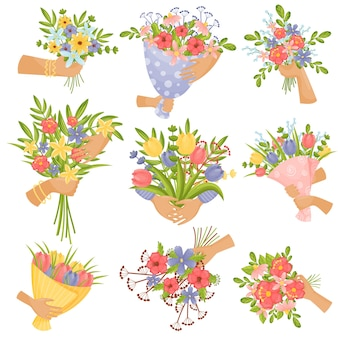Set di mazzi di fiori nelle mani