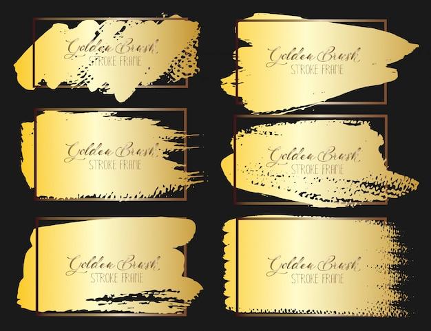 Set di telaio tratto pennello, pennellate di grunge oro. illustrazione vettoriale