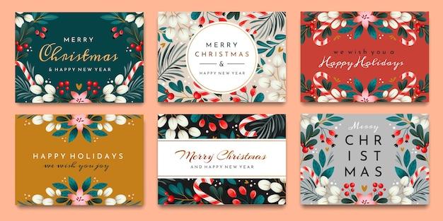 Un set di carte con i saluti delle vacanze. cartoline di natale con ornamenti di rami, bacche e foglie.