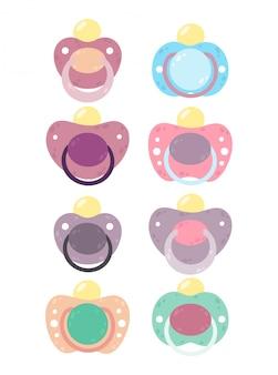 Set di ciucci per bambini. collezioni del bambino del capezzolo del capezzolo isolate su bianco