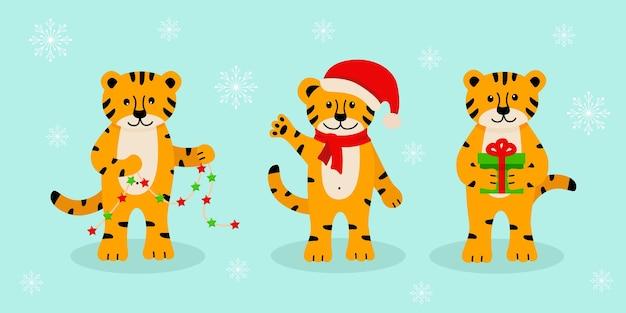 Un insieme di tigre di natale, simboli simpatici cartoni animati dell'anno. illustrazione vettoriale, il concetto di natale e capodanno.