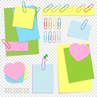 Una serie di fogli adesivi colorati per ufficio di diverse forme, bottoni e clip.