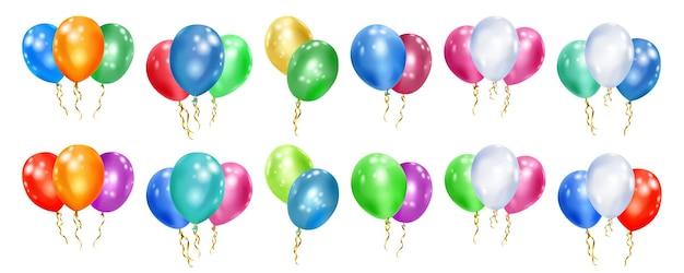 Set di palloncini colorati con nastri su bianco