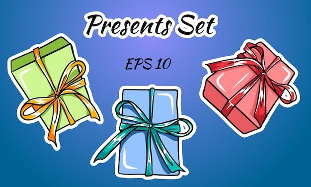 Set di scatole regalo colorate con fiocchi e nastri.
