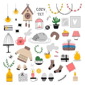 Insieme dell'illustrazione accogliente degli elementi domestici.