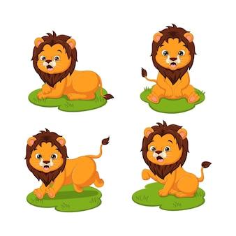 Set di cute baby leoni cartoon nell'erba