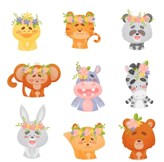 Set di simpatici animali del fumetto con i fiori sulle loro teste