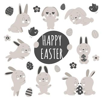 Set di simpatici coniglietti pasquali, fiori e uova decorate