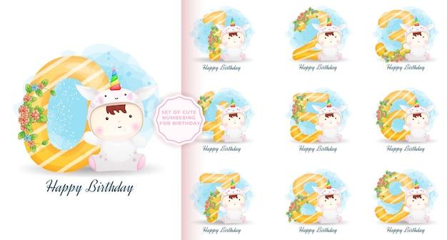Set di simpatici numeri con bambino in costume da unicorno per il compleanno