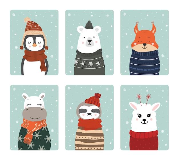 Set di simpatici animali sorridenti invernali con fiocchi di neve.