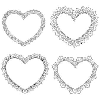 Set di cornice decorativa con fiori a forma di cuore in stile mehndi.