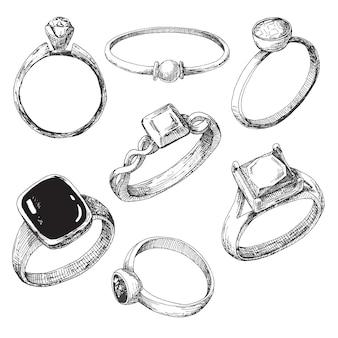 Set di anelli di gioielli diversi isolati su bianco