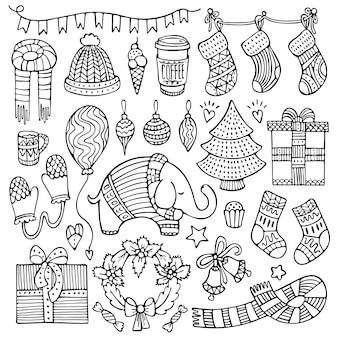 Insieme di elementi di natale e inverno doodle isolati su sfondo bianco