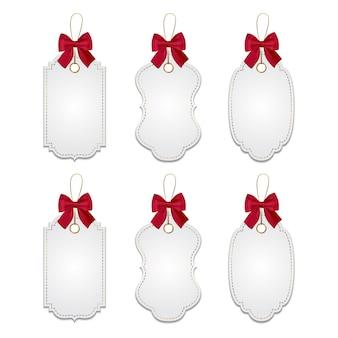 Set di tag elegante con fiocchi rossi