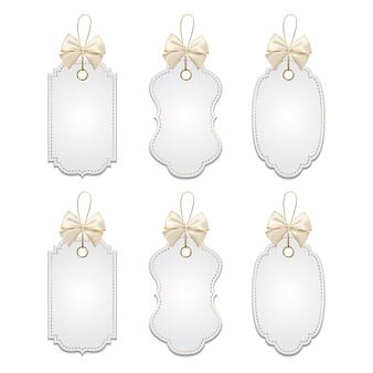 Set di tag eleganti con fiocchi d'argento e d'oro