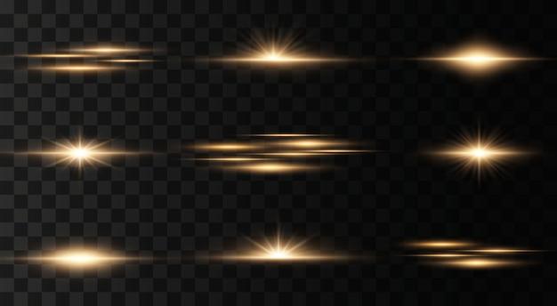 Set di lampi, luci e scintillii su uno sfondo trasparente. lampi e riflessi dorati. luci dorate astratte isolate raggi luminosi luminosi. linee luminose. illustrazione .