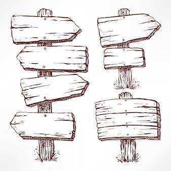 Set di quattro cartelloni pubblicitari in legno schizzo isolato su bianco