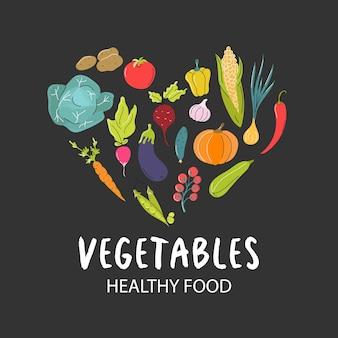 Un insieme di verdure fresche disposte a forma di cuore su uno sfondo grigio scuro cibo naturale