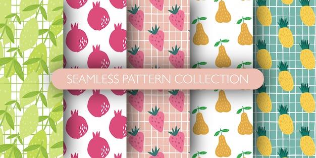 Insieme del reticolo senza giunte di frutta. raccolta di modelli - limone con foglie, melograno, fragola, pera, ananas.