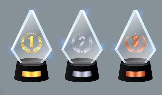 Set di premio trofeo di vetro premio vettoriale su sfondo grigio sfumato eps vettoriale
