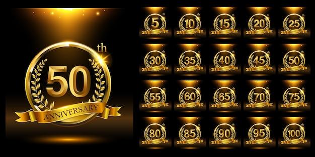 Set di modello di logo dell'anniversario d'oro con anello e rami di alloro