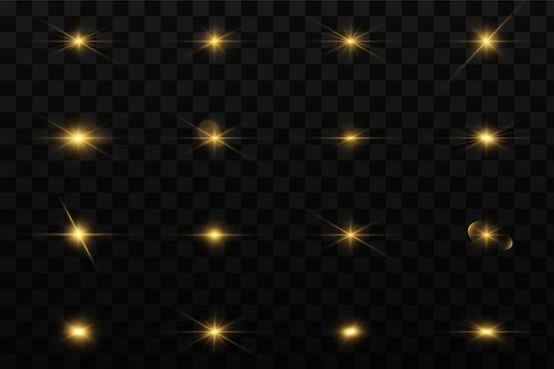 Set di effetti di luci incandescenti dorate esistenti su uno sfondo trasparente. un lampo di sole con raggi e riflettori. effetto bagliore. la stella è esplosa di splendore.