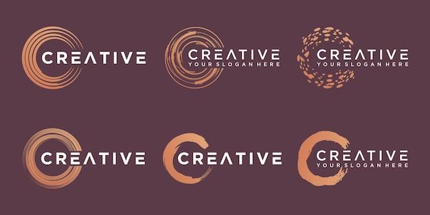 Set di elementi di pennellata a spirale dorata. turbinii. set di forme rotonde.