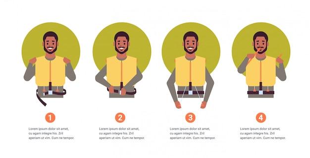 Impostare la guida da assistente di volo afroamericano steward spiegando le istruzioni con giubbotto di salvataggio in situazione di emergenza passo dopo passo concetto di dimostrazione di sicurezza ritratto orizzontale spazio di copia