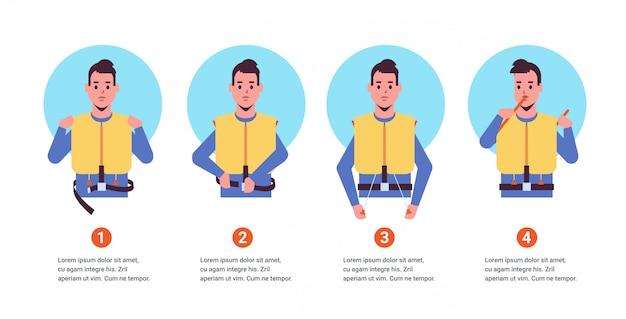 Impostare la guida dall'uomo dell'assistente di volo che spiega le istruzioni di sicurezza con il giubbotto di salvataggio dimostrazione passo dopo passo come comportarsi in una situazione di emergenza