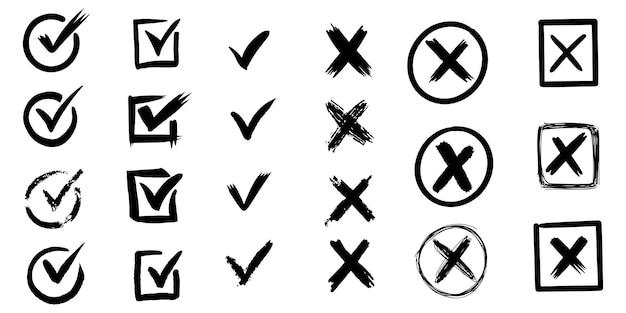 Set di segni di spunta disegnati a mano. isolato su sfondo bianco. vector segni di spunta e croce.