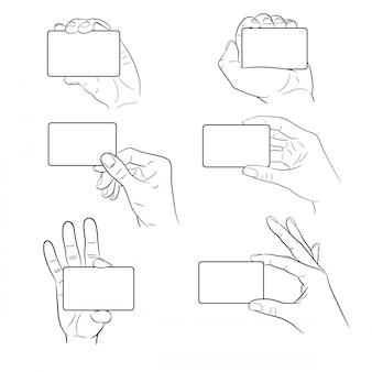 Insieme della mano che tiene carta di plastica dell'illustrazione monocromatica di vettore