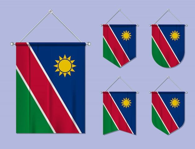 Set di appendere bandiere namibia con trama tessile. forme di diversità del paese di bandiera nazionale. stendardo modello verticale