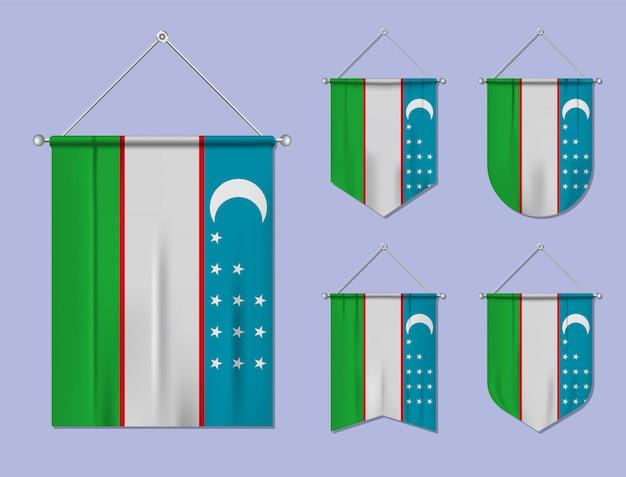 Set di appendere bandiere uzbekistan con trama tessile. forme di diversità del paese di bandiera nazionale. stendardo modello verticale.
