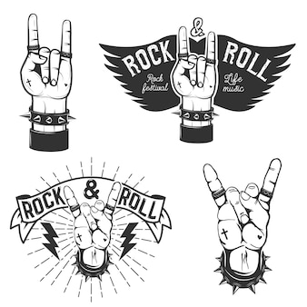 Set di mani umane con il simbolo del rock and roll. festival del rock and roll. elementi di design per poster, emblema.