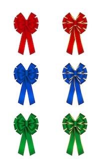 Set di fiocchi di natale isolati rosso blu verde fiocchi e fiocchi con bordi dorati