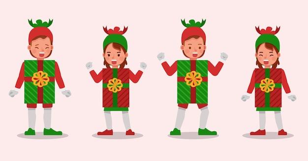 Set di bambini ragazzo e ragazza che indossa il personaggio dei costumi di natale scatola regalo