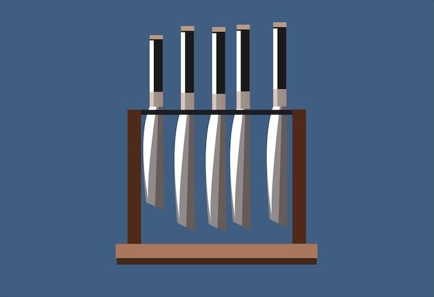 Un set di coltelli da cucina in metallo con manici neri su un supporto in legno marrone