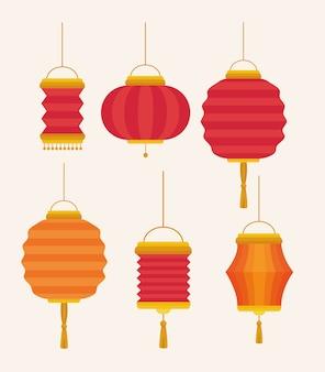 Set di lanterne cinesi appesi su sfondo bianco