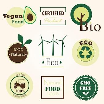 Una serie di loghi sui prodotti agricoli dell'ecologia del veganismo e sulla frutta e verdura naturale biologica flat