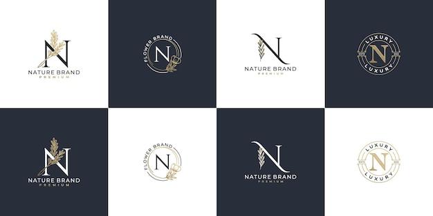 Set di modello di logo di lettera iniziale femminile di lusso n