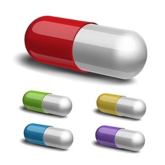Set di capsule mediche su sfondo bianco.