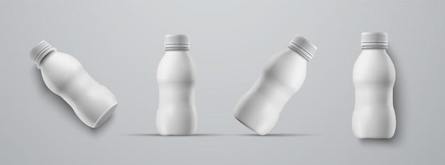 Set di mockup piccole bottiglie di plastica bianche per kefir, latte, yogurt e altre bevande. modelli per la presentazione del design dell'etichetta.