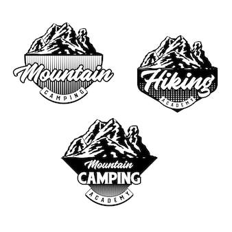 Set di badge per mountain bike e camping club. vettore