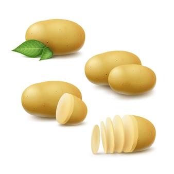L'insieme di nuove patate non sbucciate e affettate intere crude gialle con le foglie si chiude su su fondo bianco