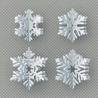 Set di nove diversi fiocchi di neve di carta tagliati da carta su sfondo trasparente.