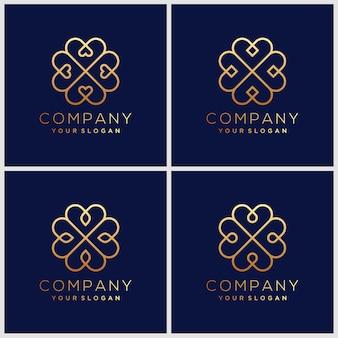 Set di modelli di design logo ornamento in stile lineare alla moda con fiori e foglie - segni realizzati con foglia d'oro