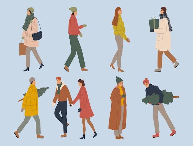 Insieme di persone, uomini e donne in abiti invernali