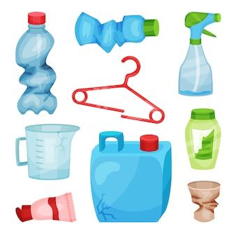 Set di rifiuti di plastica. bottiglie e tazza sgualcite, gancio rotto, scatola metallica incrinata e brocca di misurazione. tema di smistamento e riciclaggio